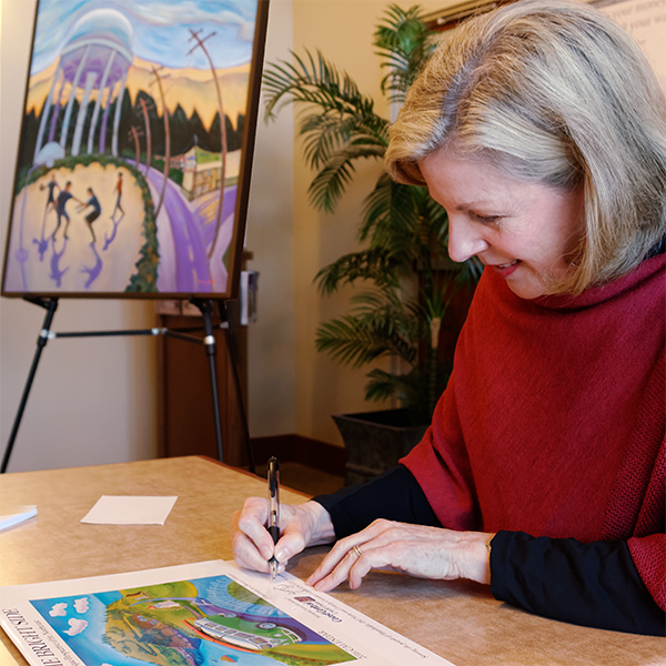 Beverly Harper signing calendars